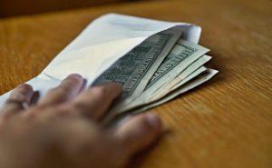 bribe-money-560x347