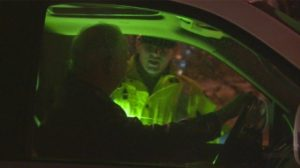 police-speak-to-driver-at-roadblock