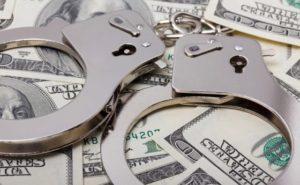 cash-handcuffs-560x347