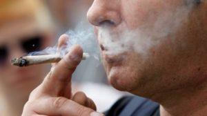 a-man-smokes-licenced-medicinal-marijuana