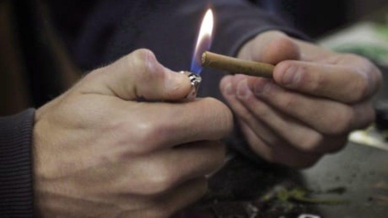 marijuana-a-man-lights-a-marijuana-joint