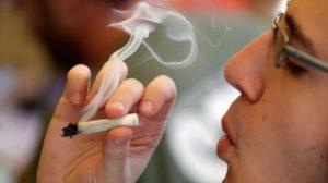 pot-taxation-a-man-smokes-a-marijuana-joint