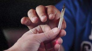 marijuana-men-pass-a-marijuana-joint